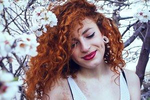 White spring, redhead woman