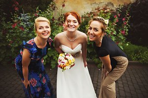 Bride poses with her pretty friends