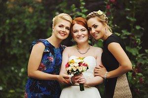 Pretty smiling bride and friends