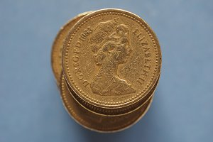 1 pound coin, United Kingdom over blue with copy space in London