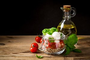Caprese salad in glass jar.