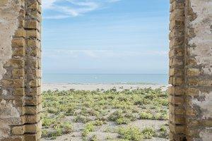 window overlooking the beach Llobreg