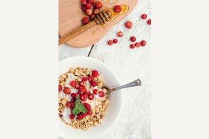 Granola with yoghurt and wild strawberries