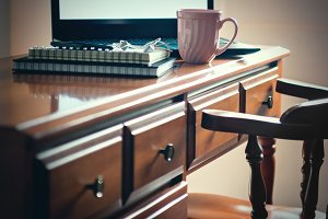 Writing desk with laptop & coffee