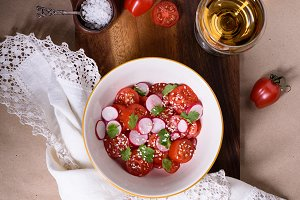 Fresh tomatoes and radishes salad