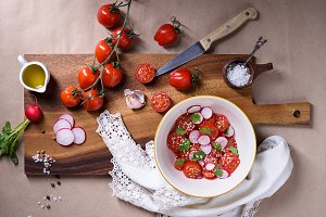 tomato salad on wooden board