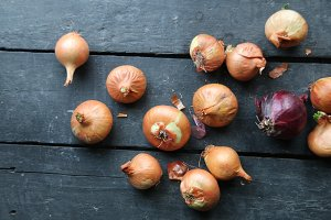 onions on rustic wood