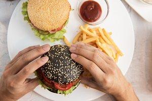 Man eating burgers