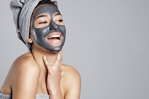 woman with a grey facial mask