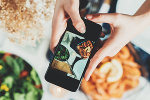 Woman taking a picture of food