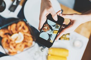 Girl taking picture of food