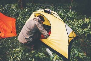 Traveler with tent camping equipment