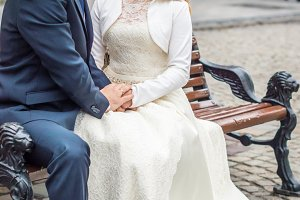 newly-weds sit on the bench