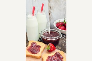 Toasts with strawberry jam and milk
