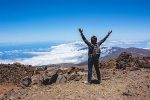 Woman after hiking to volcano summit