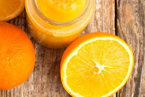 orange juice on wooden background