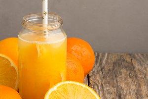 citrus juice in bottle,oranges