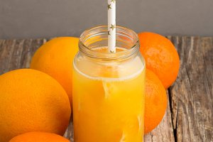 citrus juice with a straw, oranges