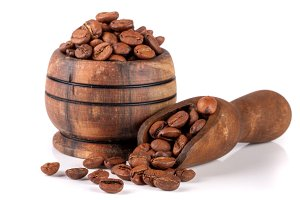 coffee beans in a wooden bowl with scoop isolated on white background