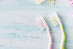 Toothbrushes on pastel backdrop