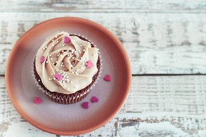 Chocolate cupcakes decorated with cream rose hearts