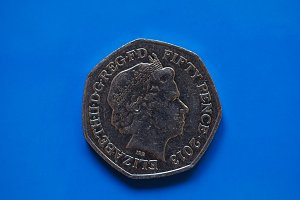 Twenty Pence coin, United Kingdom in London over blue
