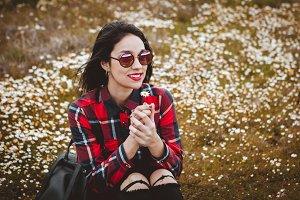 Girl smelling a daisy