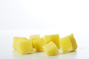 mango chunks on white background