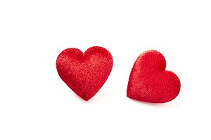 Two red hearts isolated on white background