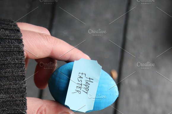 Happy Easter Hand Holding An Egg With Tag Copy Space