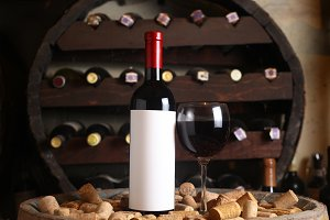 Red wine bottle in a cellar