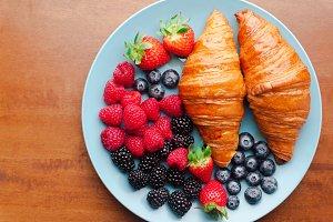 Summer breakfast on a blue plate
