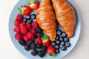 berries and hot croissants