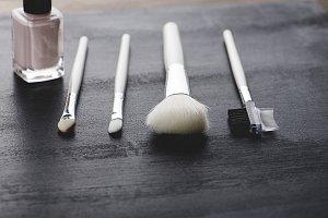 Tools to take care of eyebrows and eyelashes along with nail make-up. Horizontal shoot.