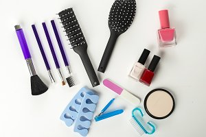 Tools for manicure, nail painting, makeup and hair styling. Horizontal shoot.
