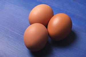 Eggs on blue background. Horizontal shoot.