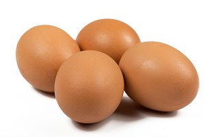Various brown eggs on white background. Isolated.