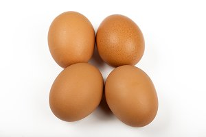 Four brown eggs on white background. Isolated.