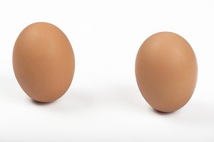 Two brown eggs on white background. Isolated.