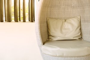 Rattan sofa seat with pillow