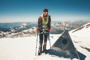 Woman climber on mountain summit