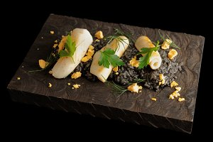 Black squid ink risotto with calamar