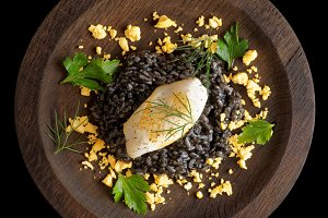 Black risotto cooked with squid ink