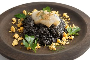 Risotto with squid ink and calamari