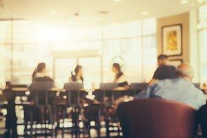 Blurred customer in coffee shop