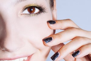 Young woman with black nails
