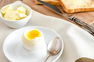 Boiled egg with crispy toasts