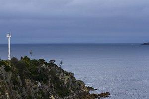 Mini lighthouse on a cliff
