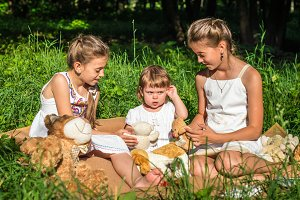 three sisters play toys in Park