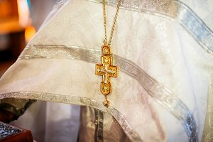 The golden cross on the priest suit, christian concept